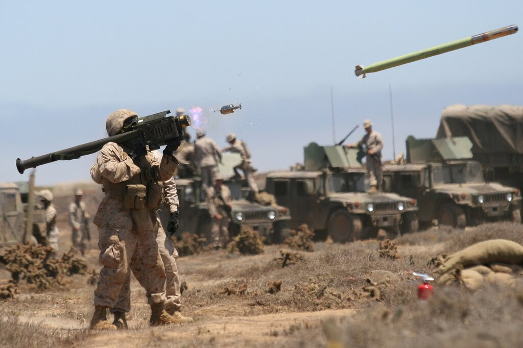 SAN CLEMENTE ISLAND, Calif. - Sgt. Joshua J. Stepp a firing pit noncommissioned officer with 3rd Low Altitude Air Defense Battalion coaches a Marine as he fires an FIM-92A Stinger missile at an unmanned aerial target during training at San Clemente Island