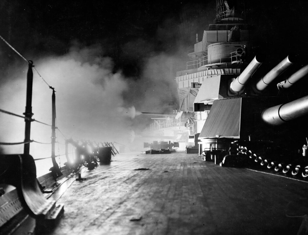 USS California (BB-44). Firing her starboard 5''⁄51 secondary battery, during night battle practice in 1933.