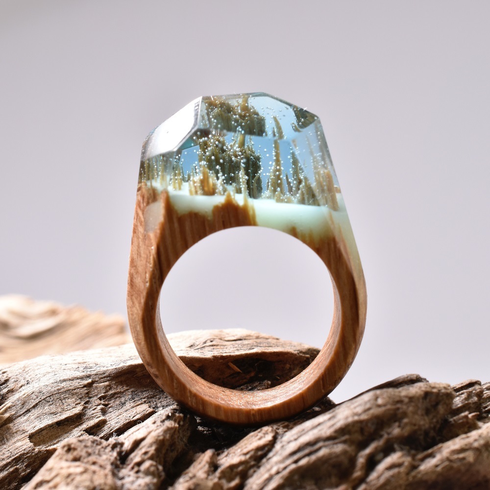 Snowy Mountains and Undersea Worlds Encapsulated Within Wood and Resin Rings