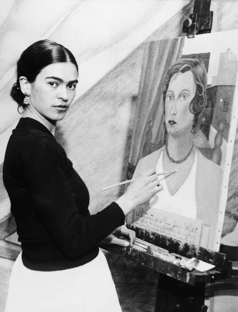 Original Caption: 1/22/1931- Even though her famous husband sits by and declines to comment on her art ambitions, Mrs. Diego Rivera, wife of the famous Mexican artist, can and does, do very passable portraits.  Photo shows Mrs. Diego Rivera painting one n