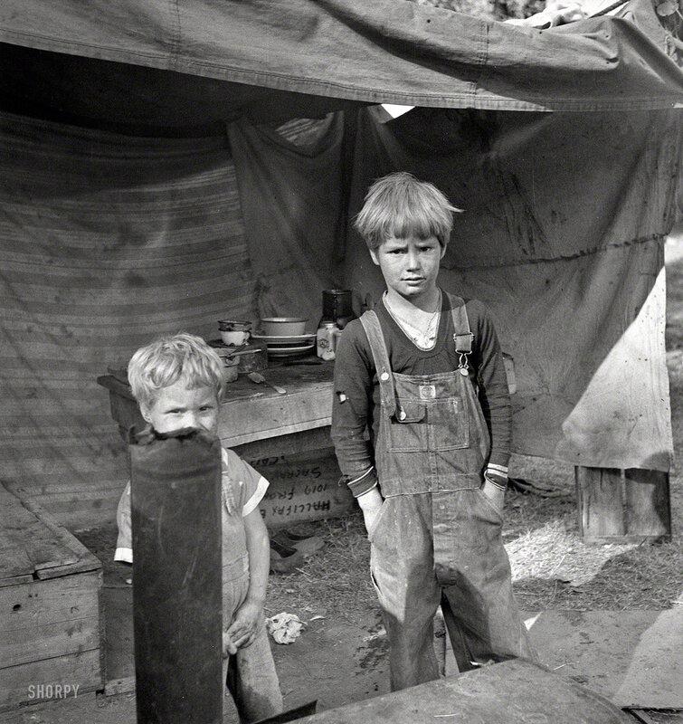 November 1936. American River camp near Sacramento, California. Children of destitute family. Five children aged two to seventeen