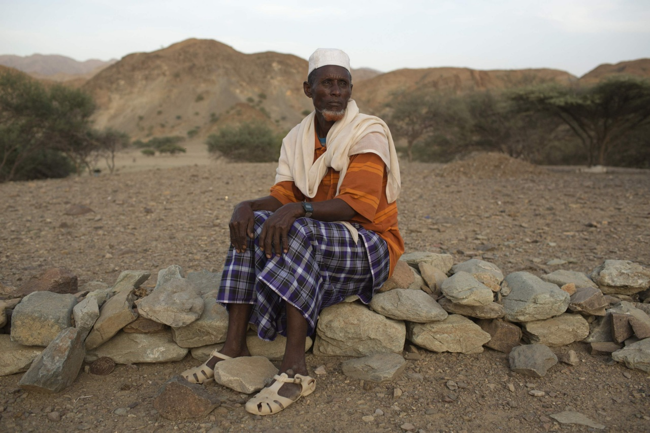 Abdu Ibrahim Mohammed, a retired salt merchant, poses close to his home in the town of Berahile in Afar, northern Ethiopia