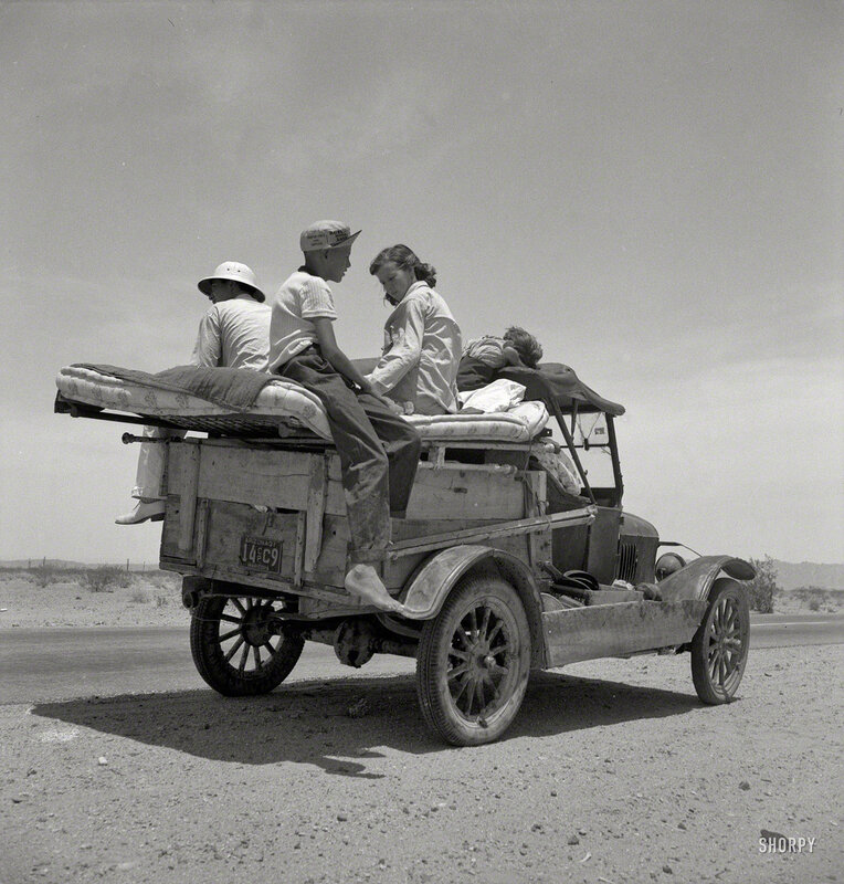 May 1937. Migratory family traveling across the desert in search of work in cotton at Roswell, New Mexico. U.S. Route 70, Arizona