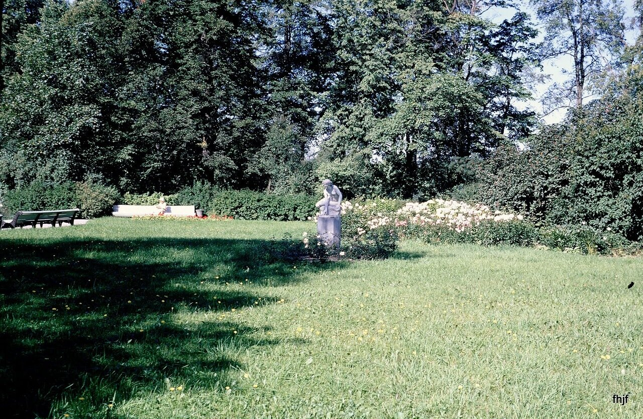 statue & overgrown garden - on way to buses - Kodachrome