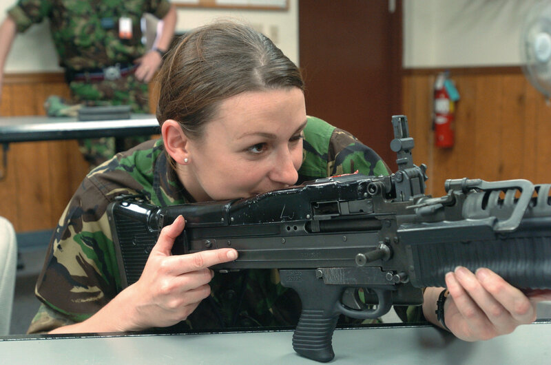 Squadron Leader (SQL) Tori Thomas of the British Royal Air Force (RAF) handles an M60 7.62 mm Machine Gun during a demonstration at the Combat Arms Training and Maintenance (CAT) facility, Shaw Air Force Base (AFB), South Carolina (SC).  RAF personnel are