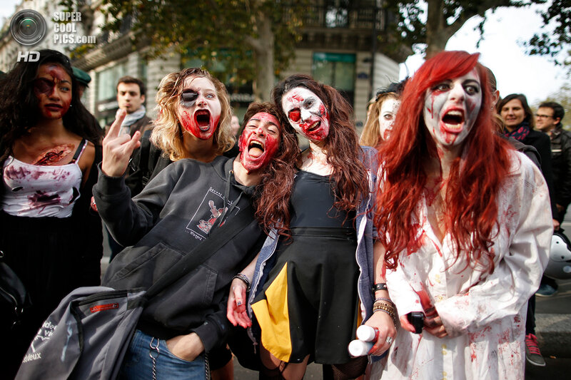 Women dressed as zombies participate in a Zombie Walk procession in the streets of Paris