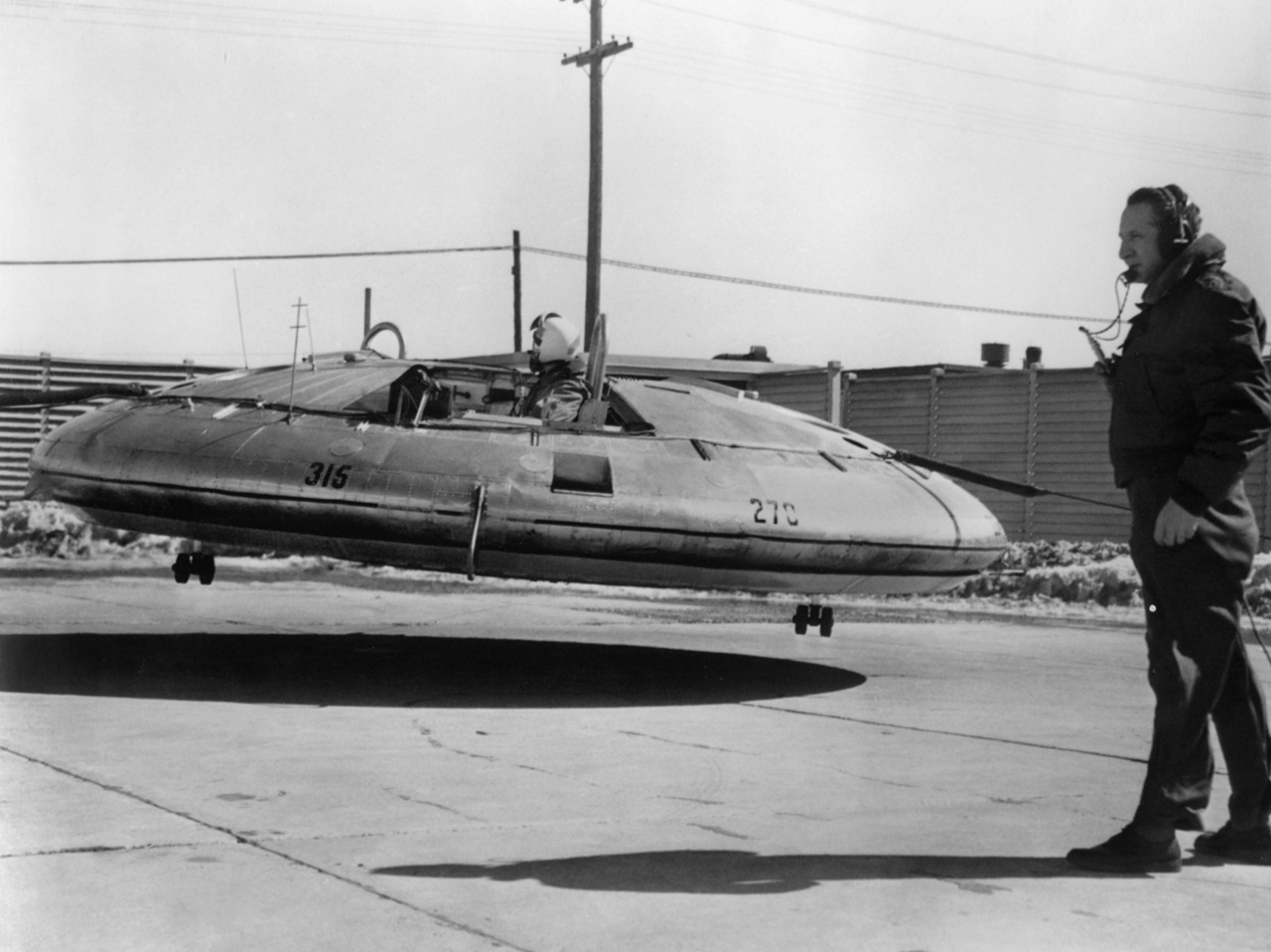 Before free-flight tests, the Avrocar was flown with tethers, seen here in front and behind the aircraft, for safety reasons. (U.S. Air Force photo)