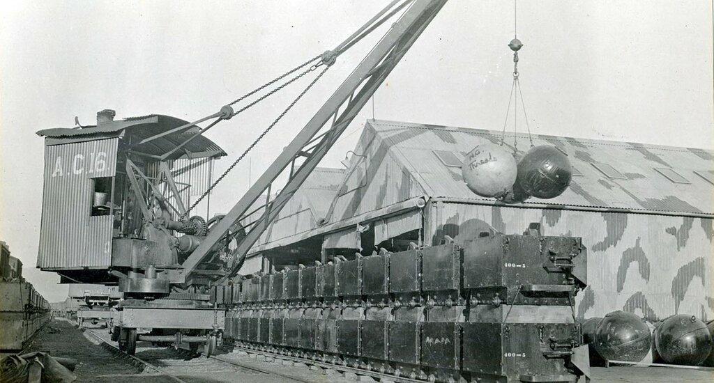 """Unloading unassembled mines """"eggs"""" at the Navy Yard's Foreign Base at Inverness, Scotland."""
