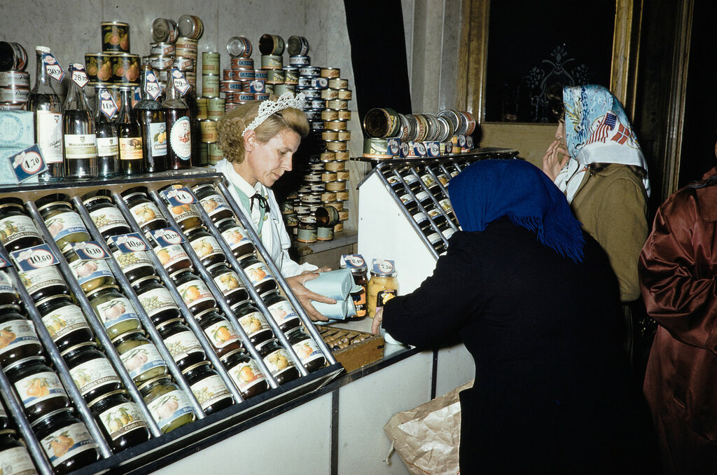 Russia, customer purchasing preserved foods at store in Moscow