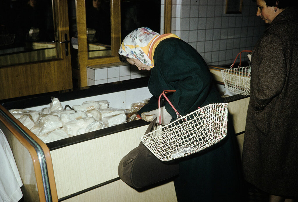 Russia, woman looking at frozen meats at store in Moscow