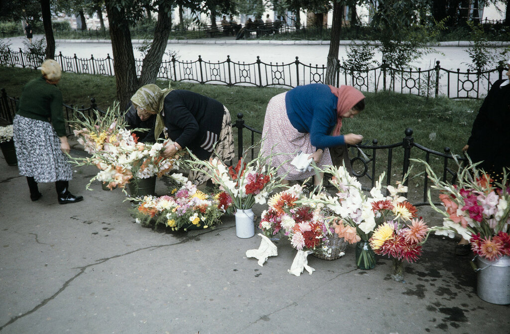 Russia, women selling flowers on sidewalk in Khabarovsk