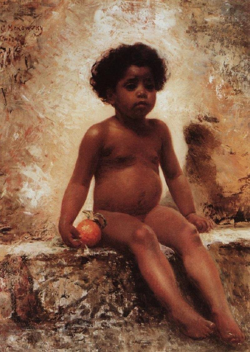 young arab boy with orange.