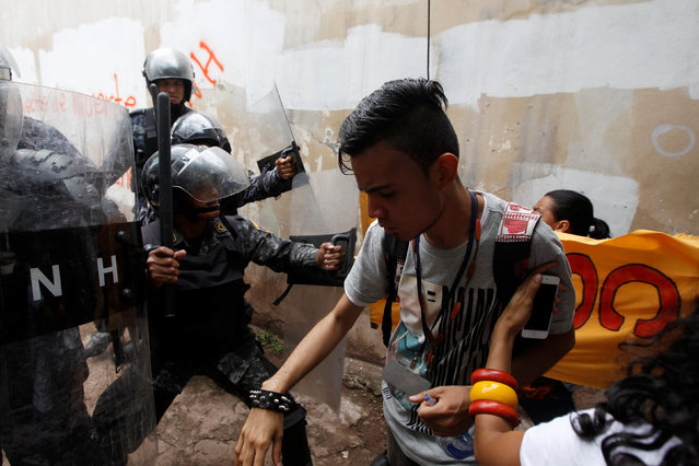 Demonstrators scuffle with policemen during a protest to demand justice over the murder of environme