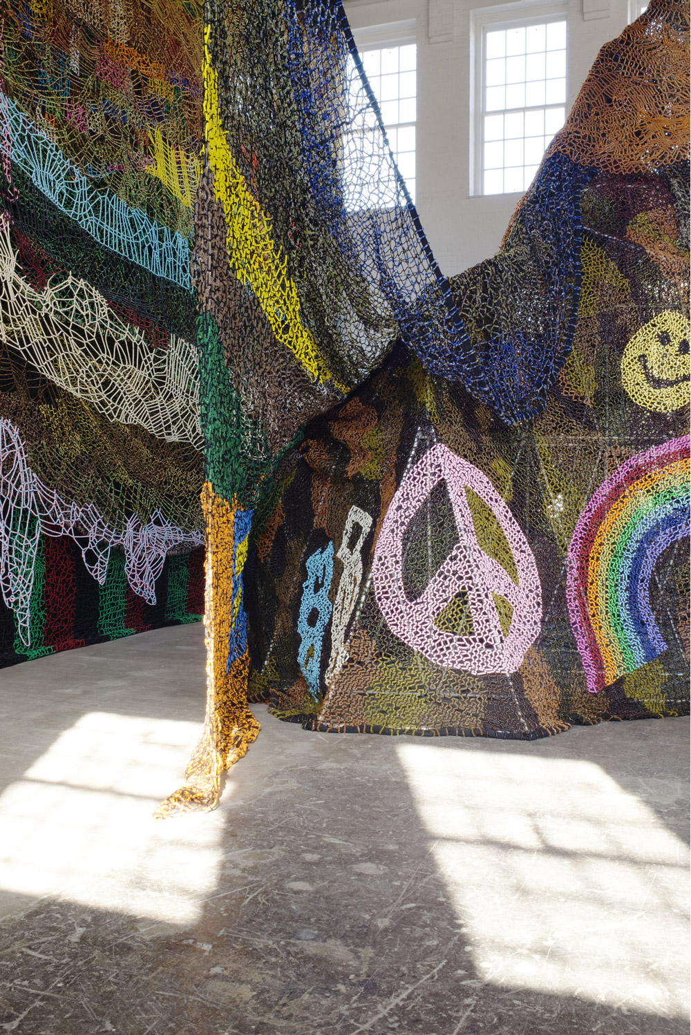 Tens of Thousands of Metallic Lawn Ornaments Glisten Inside Nick Cave's Monumental Installation at MASS MoCA