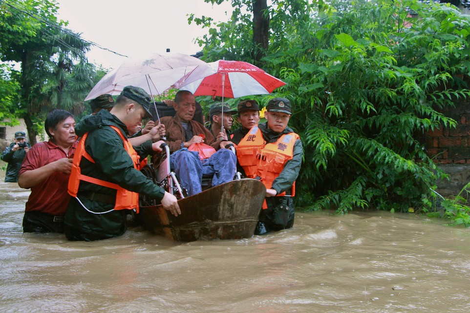 Rescuers save a resident from a flooded area in Anqing