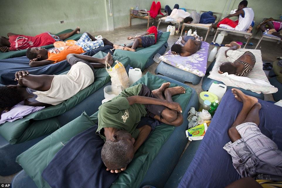 Арестанты в тюремном изоляторе. Гаитянская прокуратура и борцы за права человека уже давно подняли т