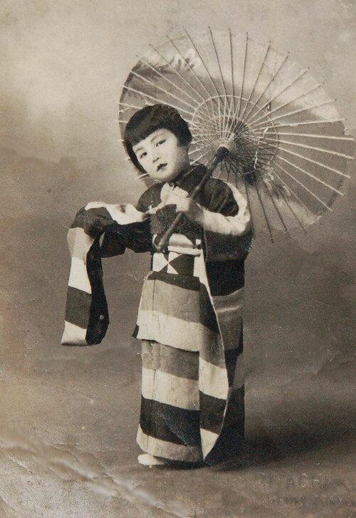 Girl in furisode kimono.  About 1900, Japan