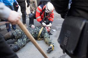 При столкновениях в Киеве погибли не менее 18 человек