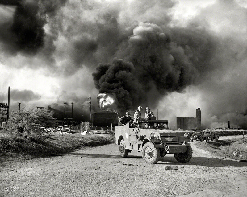April 17, 1947. Armed troops form a roadblock at Texas City, Texas, as all persons, including workers, were barred from entering the area where new explosions were expected
