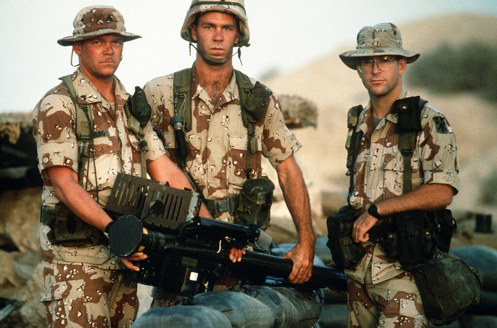 Members of Btry. A, 5162nd Air Defense Arty. Regt., 11th Air Defense Arty. Bde., hold an FIM-92A Stinger portable missile launcher as they pose for a photograph during Operation Desert Shield.  (USAF PHOTO BY SSGT F. LEE CORKRAN DA-ST-92-06695)