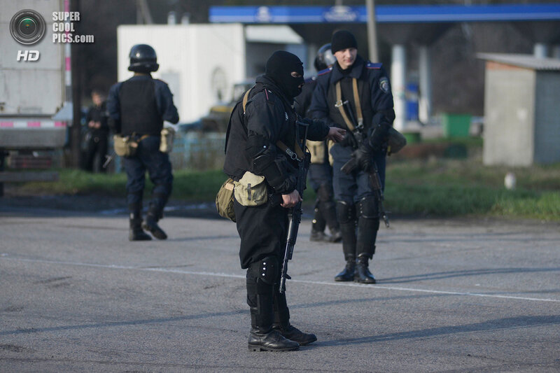 Ukrainian troops stand guard at a checkpoint near the city of Izium in the Kharkiv region of east Ukraine