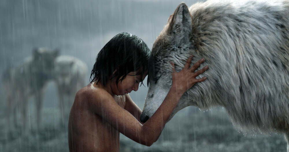 THE JUNGLE BOOK (L-R) MOWGLI (Neel Sethi) and RAKSHA (voiced by Lupita Nyong'o). ?2015 Disney Enterprises, Inc. All Rights Reserved.