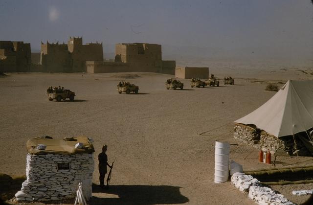 1955-56 Yemen Aden Protectorate - Mukalla Convoy Leaving Fort Atag by Brian Brake.jpg