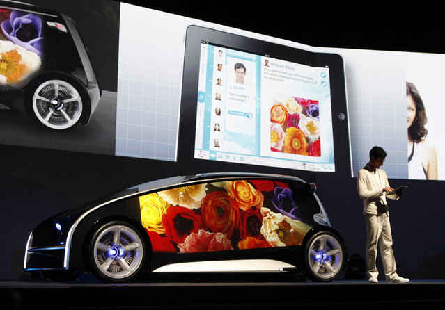 A model presents Toyota's concept vehicle Fun-Vii at a pre-Tokyo Motor show reception in a show