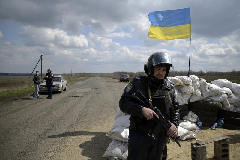 A Ukrainian soldier stands guard at a checkpoint near the city of Barvenkovo in the Kharkiv region of east Ukraine