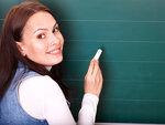 Student writing on blackboard.