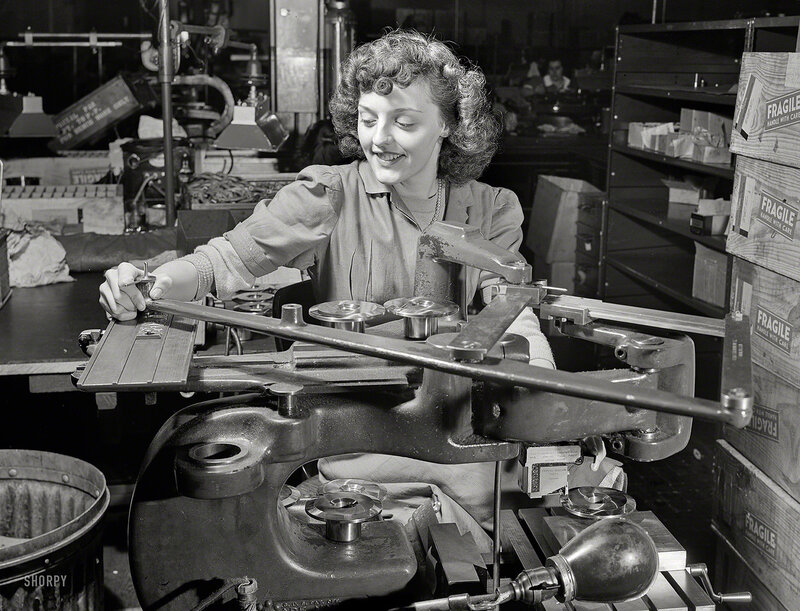 Circa 1942. We've lost the caption for this photo of a lady operating yet another War-Winning Widget in Factorytown, USA
