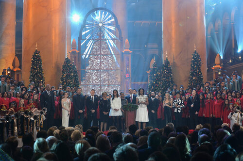 WASHINGTON, DC - DECEMBER 15: (L-R) Charles Barkley, Anna Kendrick, Hugh Jackman, Nick Carter, Marian Shields Robinson, Malia Obama, Sasha Obama, US President Barack Obama, First Lady Michelle Obama, A.J. McLean, Sheryl Crow, Janelle Monae, and Patrick M