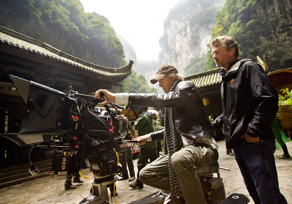 Director Michael Bay lines up a shot for camera operator John Skotchdopole in Wulong Karst National Park in Southeast China