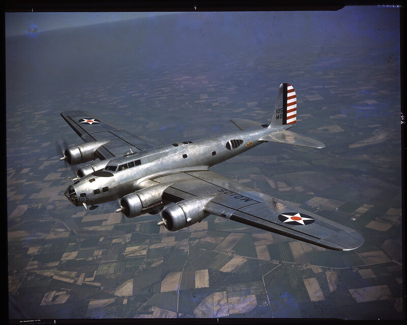 High one-half left front aerial view of U.S. Army Air Force Boeing B-17C Flying Fortress (tail number {105MD}) in flight, the aircraft is assigned to Wright Field, ca. 1941.