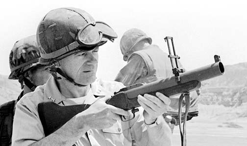 U.S. Commander, South Atlantic, RADM James S. Elfelt, practice fires the M-79 grenade launcher.  The admiral was here observing the American and the Peruvian marines during Operation Unitas XXII.