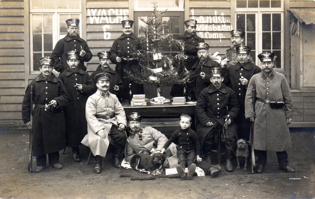 Note on reverse 'Weihnachten 1914 in Belgien. St. Ruppert.'Soldiers from the 5th Kompagnie, Landsturm Infanterie Bataillon 'Wiesbaden' (later Landsturm Infanterie Regiment 37) pose for a festive photograph to send home to their frie