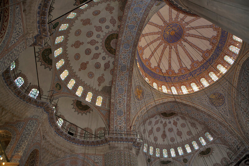 The ornate decorations of the walls and ceiling inside the prayer hall of Istanbul's Blue Mosque.