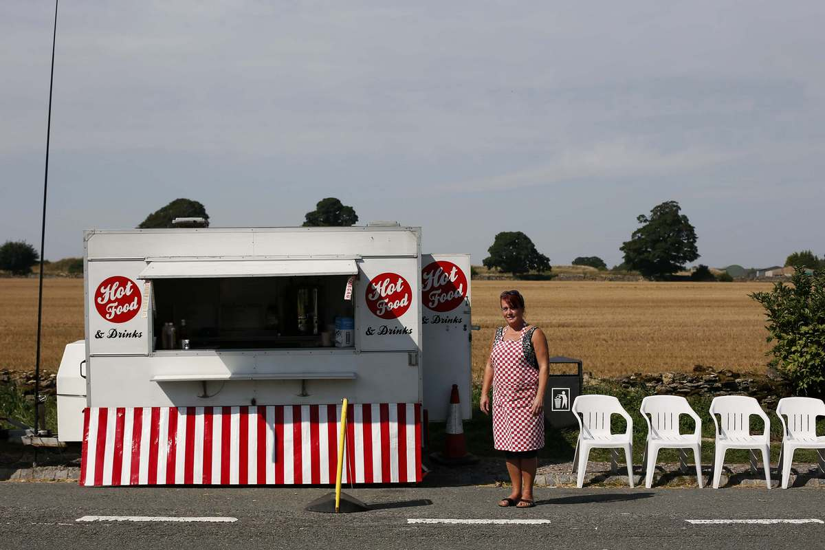 Vanessa Burras poses for a photograph outside her snack van along the A49 near Bristol