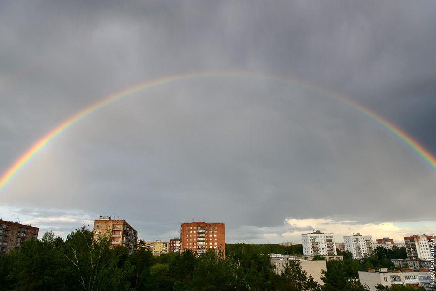 фотография радуги над городом