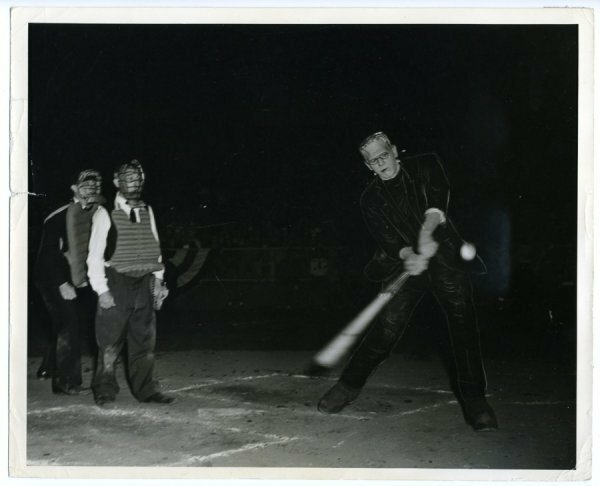 Boris Karloff in his Frankenstein costume playing baseball, with Buster Keaton as the catcher