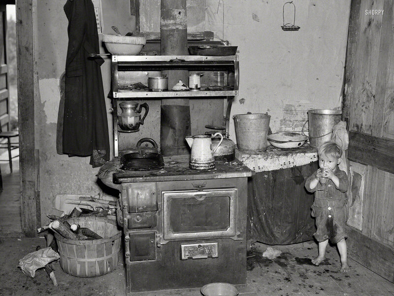 June 1937. Child of Earl Taylor in kitchen of their home near Black River Falls, Wisconsin