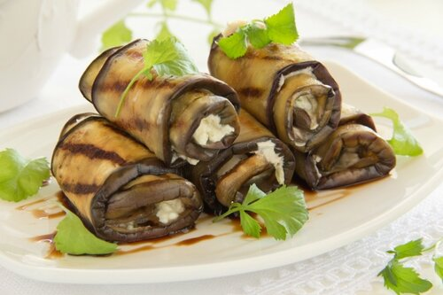Appetizer of eggplant rolls with..