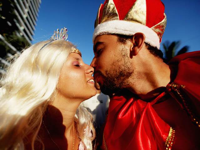 RIO DE JANEIRO, BRAZIL - FEBRUARY 18: Brazilian revelers kiss during Carnival celebrations along Ipanema beach on February 18, 2012 in Rio de Janiero, Brazil. Carnival is the grandest holiday in Brazil, annually drawing millions in raucous celebrations c