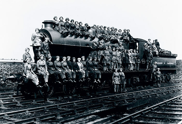 Women cleaners sitting on a locomotive, West Yorkshire, 23rd March 1917.