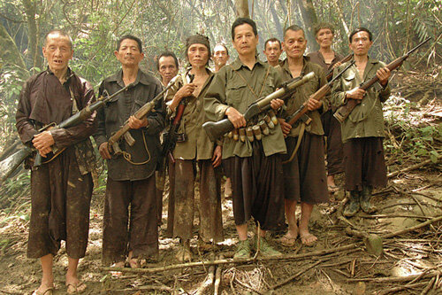 Village leader, Blia Shoua Her (center), holding an old American M-79 grenade launcher and surrounded by former Hmong fighters from the CIA's Secret Army, near Vang Vieng, Laos, July 3, 2006.  Most of the men are from surrounding CIA Lima Sites 363, 319,