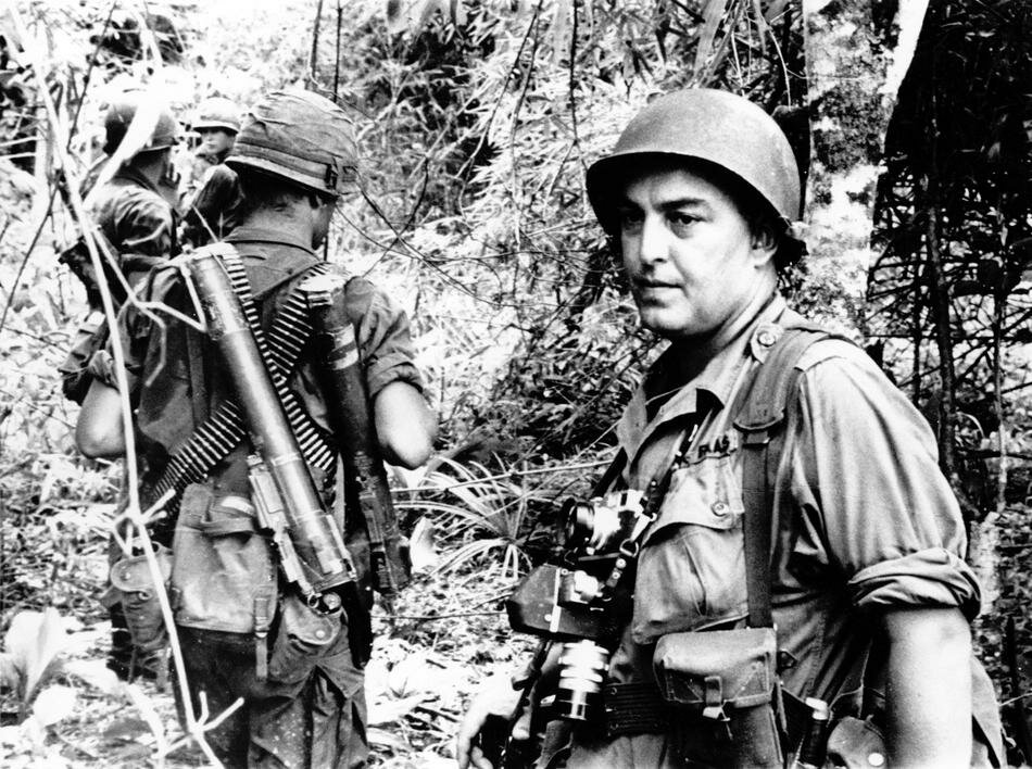 In this undated photo, Associated Press photographer Horst Faas is shown on assignment with soldiers in South Vietnam. (AP Photo)