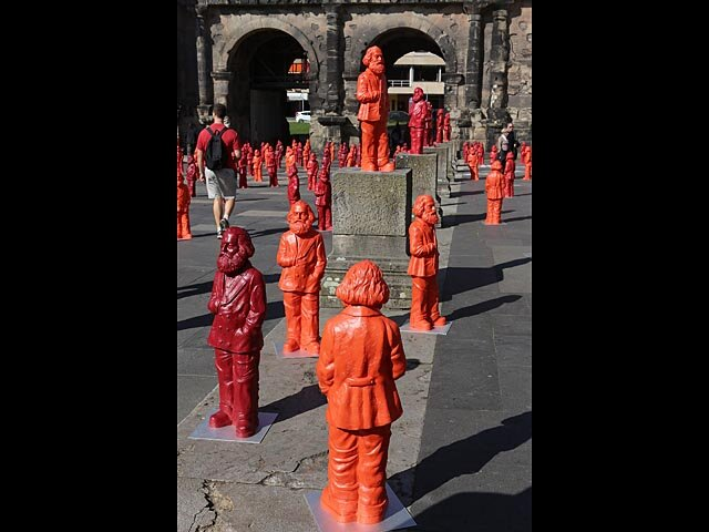 TRIER, GERMANY - MAY 05: Visitors walk among some of the 500, one meter tall statues of German political thinker Karl Marx on display on May 5, 2013 in Trier, Germany. The statues, created by artist Ottmar Hoerl, are part of an exhibition at the Museum S