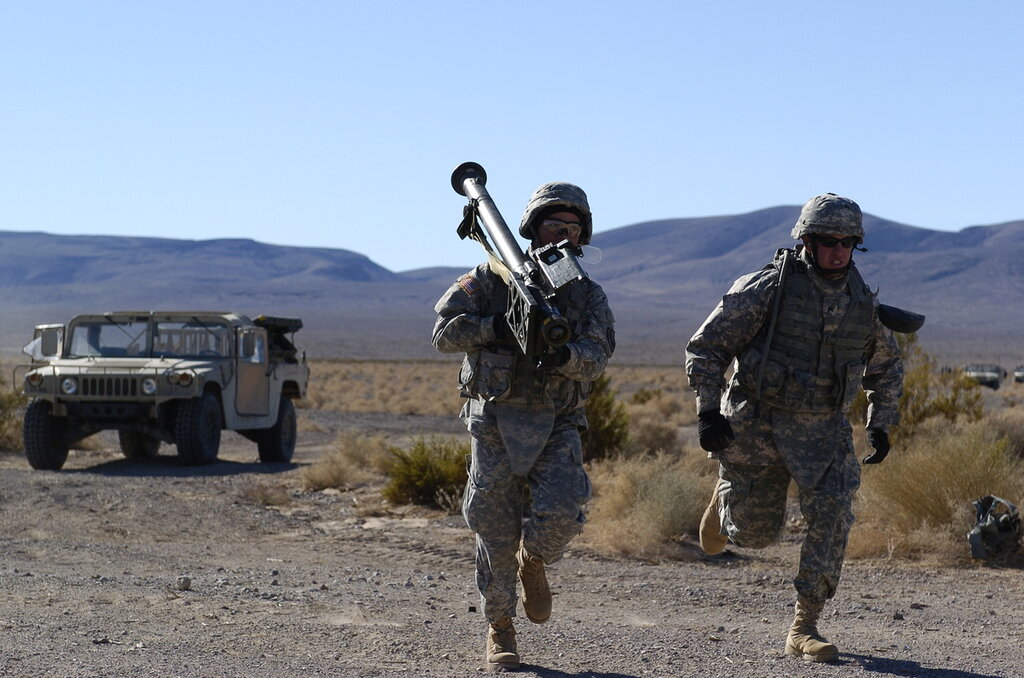 SPC Gary running with a  Stinger Shoulder Fired Missile Weapon System for a target engagement on 10 Dec 2008.