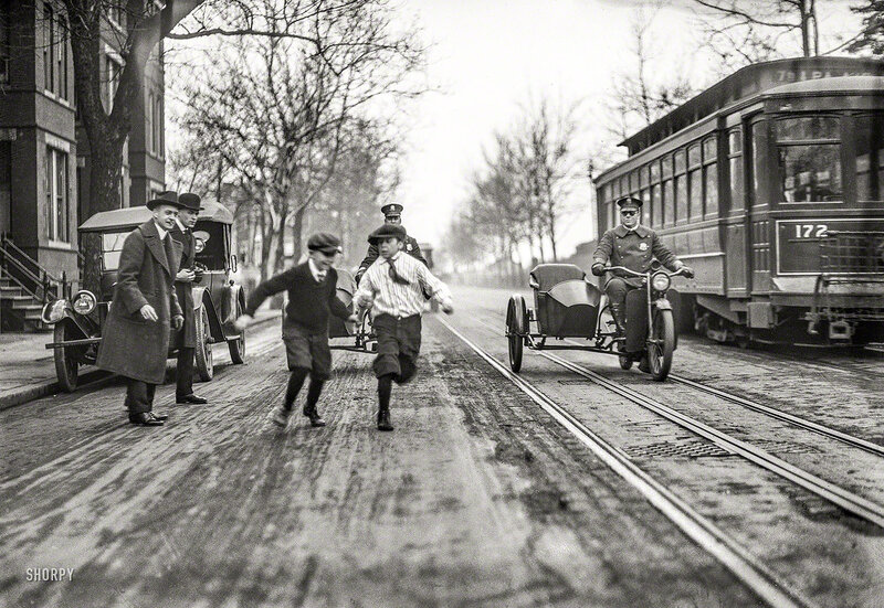 Washington, D.C., circa 1922. Children, police motorcycles with sidecars, and streetcar in street
