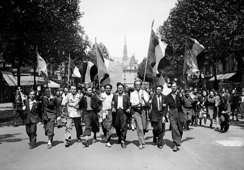 Picture dated of May 8, 1945 showing Parisians wearing French flags and marching in the streets of Paris to celebrate the unconditionnal German capitulation at the end of the second World War.